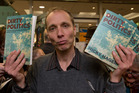 Author Nicky Hager with copies of his book, Dirty Politics, at the launch in Wellington. Photograph by Mark Mitchell