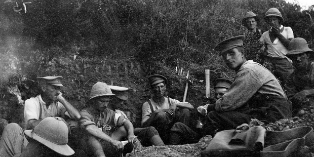 New Zealand soldiers, believed to be from the Wellington Mounted Rifles occupying a trench on Table Top during the night of August 6, 1915, as they prepare for the attack on Chunuk Bair. Picture / James Cornelius Read / Alexander Turnbull Library