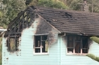 A body has been found in the remains of a burned down house in Porirua.