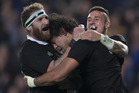 All Blacks forward Steven Luatua celebrates with Kieran Read and TJ Perenara after scoring the final try against the Wallabies. Photo / Brett Phibbs