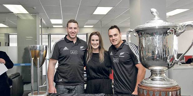 STAR VISIT: All Blacks Luke Romano and Israel Dagg with Hawke's Bay Today advertising manager Catrina O'Connell. Photo/Paul Taylor