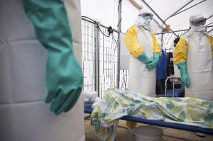 NGO workers at an Ebola training session with a mannequin in Brussels. Photo/ AP
