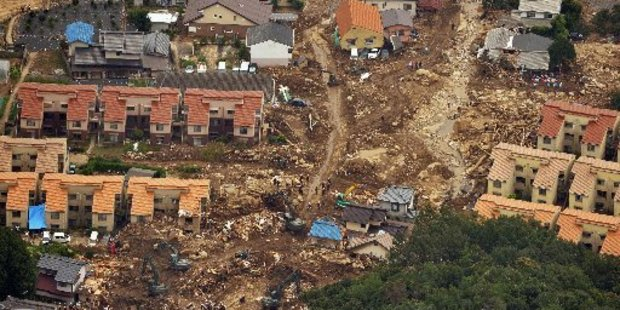 Rescuers search through landslide debris in Hiroshima. Photo / AP