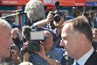 Prime Minister John Key faces off with Bernie Monk in Greymouth. Photo / Greymouth Star