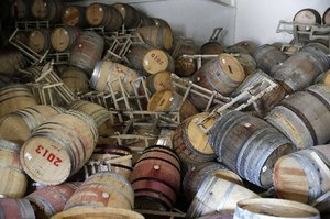 Barrels filled with Cabernet Sauvignon toppled onto one another during Sunday's earthquake. Photo / AP