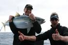 Team NZ skipper Dean Barker with his catch and an enthusiastic Matt Watson.