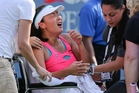 A distressed Peng Shuai receives attention. Photo / AP