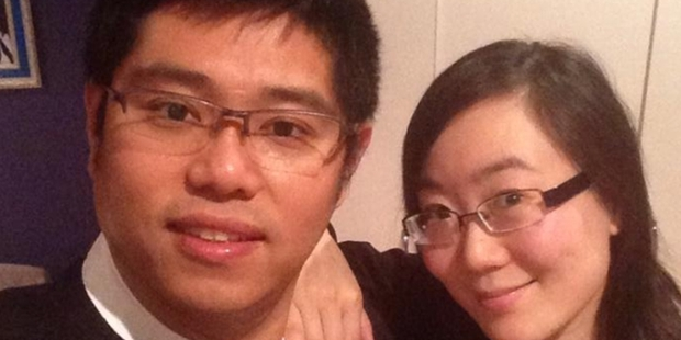 Cecilia Wang, pictured with husband Jimmy Qiu, was hit in the head by shrapnel from a fireworks display at Eden Park.