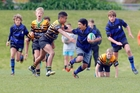 Te Puna's Kahi Borell fends off a Greerton tackler in the WBOP JMC Under-13 final played last weekend. Photo / Andrew Warner