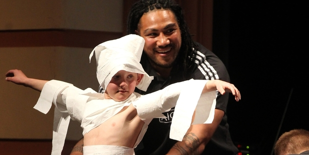 Sam Kerr, 9, Napier, was dressed up in toilet paper by All Black Ma'a Nonu during a game at the event. Photo / Duncan Brown