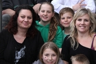 Steph Usmar, left, and June Lyall with their children. Photo / Vision Media