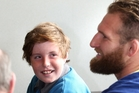 All Black No 8 Kieran Read takes time to talk to fan and cystic fibrosis sufferer Tim Donkin in Napier yesterday. Photo / Duncan Brown