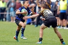 Te Puna's Te Hiringa Hunt runs into a tackle in the  under-13 final against Greerton Chargers. Photo / Andrew Warner
