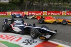 Mitch Evans (foreground) passes Raffaele Marciello at Spa Francorchamps, where he put himself back into contention for a top three finish. Photo / GP2Media