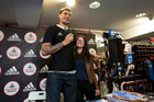 Steven Adams poses with a fan during a signing session in Auckland today. Photo / Brett Phibbs