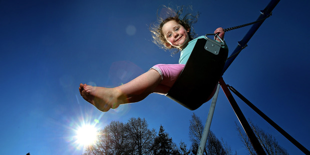Tyrah Anderson enjoys the sunshine at Memorial Park. Photo/John Borren
