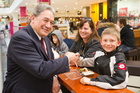 Winston Peters talks with ten year old Jackson Kirk, who thought he was the President when Mr Peters visited the mall on Thursday. Photo / Greg Bowker