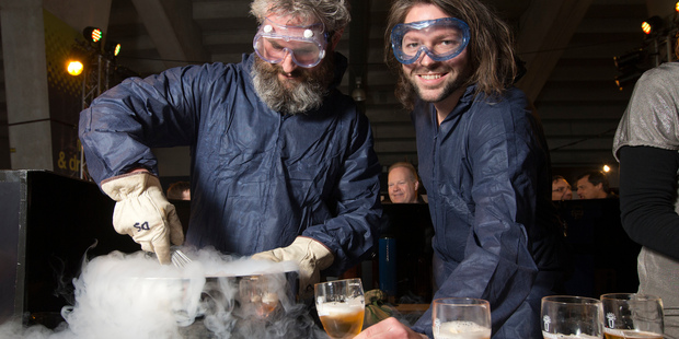 Garage Project brewer Pete Gillespie (left) and co-founder Jos Ruffell create a beer foam with liquid nitrogen during Wellington's Beervana festival. Photo / Mark Mitchell
