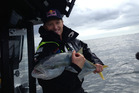 Jimmy Spithill with his kingfish.