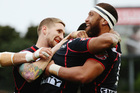 Dominique Peyroux of the Warriors celebrates with Sam Tomkins and Manu Vatuvei after scoring a try during the NRL match between the Warriors and the Titans. Photo / Getty Images