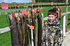 Children caught eels while adults nabbed wild pigs and possums at the annual Chatham Islands hunt. Photo / Clare Gleeson