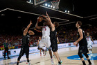 Kenneth Faried of the U.S, duels of the ball in front New Zealand's Tai Webster, left, and Rob Loe, second right, during the Group C Basketball World Cup match, in Bilbao. Photo / AP