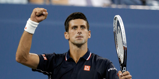 Novak Djokovic, of Serbia, reacts after winning a game against Andy Murray, of Britain, during the quarterfinals of the U.S. Open tennis tournament. Photo / AP