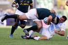 Argentina's Agustin Creevy, right, tackles South Africa's Frans Malherbe during their Rugby Championship match in Salta, Argentina. Photo / Getty Images