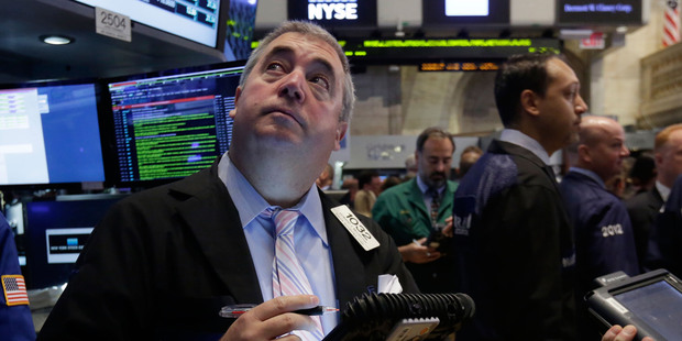 Trader Edward McCarthy, left, works on the floor of the New York Stock Exchange. File photo / AP