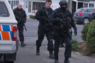 Police Armed Offenders Squad members returning to the Ashburton Police Station after apprehending armed fugitive Russell John Tully. 1 September 2014 New Zealand Herald Photograph by Mark Mitchell.