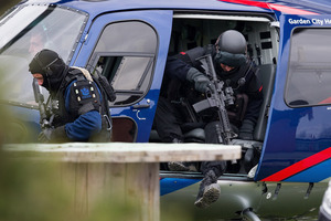 AOS members exit a helicopter in Ashburton. Photo / Martin Hunter