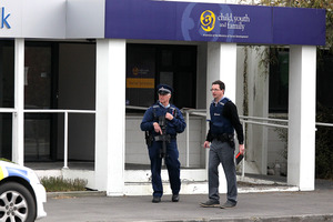 Police at the scene of the double shooting in Ashburton. Photo / Martin Hunter