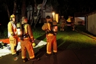 Firefighters attend the scene of a suspicious blaze at Paihia's historic Williams House. Photo / Peter de Graaf