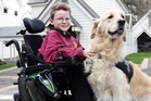 Michael Wheeler and his mobility pal, Friend, at King's School in Auckland. Photo / Doug Sherring
