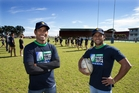 Nanda Majhi (left) and Tiger Ahmed get a taste of rugby Auckland-style. Picture / Brett Phibbs