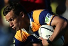 MOUNT MAUNGANUI, NEW ZEALAND - AUGUST 24: Jono Kitto of the Bay of Plenty Steamers is tackeled during the ITM Cup match between Bay of Plenty and Tasman on August 24, 2014 in Mount Maunganui, New Zea