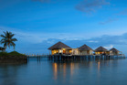 Overwater fales at Coconuts Beach Club Resort and Spa. Photo / Supplied