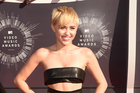 Miley Cyrus is set to debut her first collection of art during New York Fashion Week. Photo / AFP