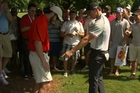 Rory McIlroy spots his ball.