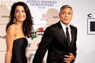 US actor George Clooney and his fiancee Amal Alamuddin. Photo / AFP