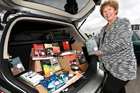 Literacy Bay of Plenty literacy manager Annamaria Grafas says 200 new books will be gifted to people tomorrow if they pledge to pass them on. Photo / George Novak