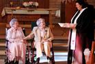 Rev. Linda Hunsaker presides over the wedding of Vivian Boyack, left, and Alice 'Nonie' Dubes, center, in Davenport, Iowa. Photo / AP