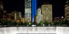 The Tribute in Light rises behind buildings adjacent to the World Trade Center complex and a reflecting pool at the National September 11 Memorial. Photo / AP