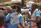 File photo of health workers teaching people about the Ebola virus in Conakry, Guinea, on March 31, 2014. Photo / AP.
