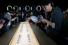 Apple watches are examined by members of the media during Apple's new product release last week. Photo / AP