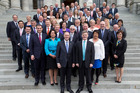 Prime Minister John Key and Deputy Prime Minister Bill English pose for photographs with their 61-strong-caucus on Parliament steps. Photo / Mark Mitchell