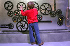 Young Theo experiments with Motat's new 'Welcome to the Machine' exhibition. Photo / Mark Wardle