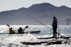 Kayakers and anglers enjoy a day on the water, despite worries over its health. Photo / Paul Estcourt