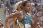 Cathy Freeman outpaces her rivals, as Australia outpaces NZ. Photo / Paul Estcourt