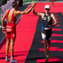 Jan Frodeno of Germany (left) welcomes home 2nd place Richie Cunningham from Australia in the men's section of the Ironman 70.3 Auckland. Photo / Richard Robinson